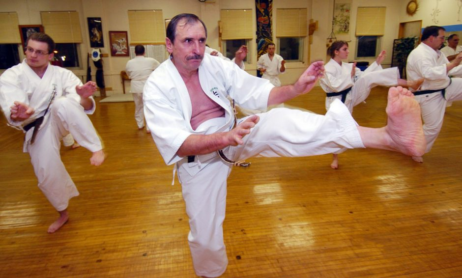 Ihor Rymaruk, who first learned karate while in the Marine Corps in Okinawa, leads one of his twice-weekly classes Thursday at his school in Amsterdam.