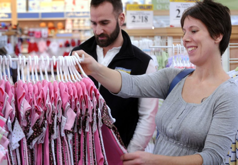Heather Mason of Schenectady, who is 6 months pregnant with her first child, shops for baby clothes at Babies 'R' Us in Latham with her fiancé Andrew Rizzi, left.