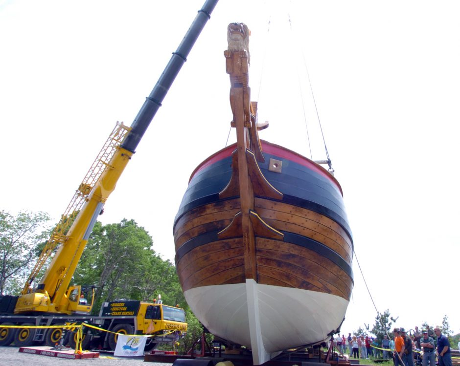 A 130-foot boom crane holds the Onrust in slings.