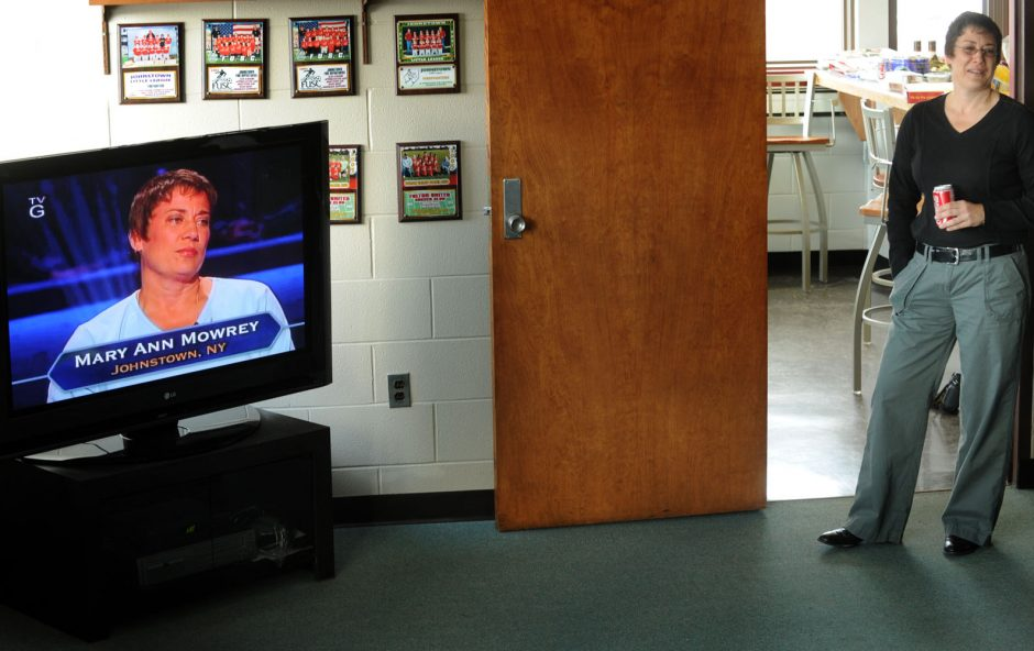 "Mary Ann Mowery, a Johnstown firefighter, watches herself on ""Who Wants To Be A Millionaire"" in the day room of the Johnstown fire station on North Perry Street Wednesday."