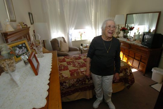 Barbara Rossi shows off her room at the Heritage Home for Women at 1519 Union Street in Schenectady. Rossi is one of 36 women living in the building, which was built in 1908.
