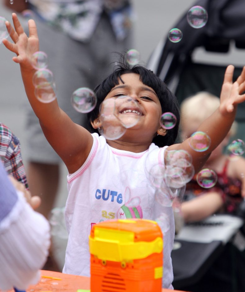Tista Goswami, 4, of New York City, plays with bubbles during open house festivities at Saratoga Race Course on Sunday.