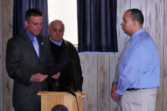 Amsterdam city Alderman Dan Roth, left, an Iraq War veteran, joined by Alderman Richard Leggiero, center, reads a proclamation from the city of Amsterdam honoring Iraq War veteran Jeffrey Walton, right, at American Legion Post 701 in Amsterdam on Thursday