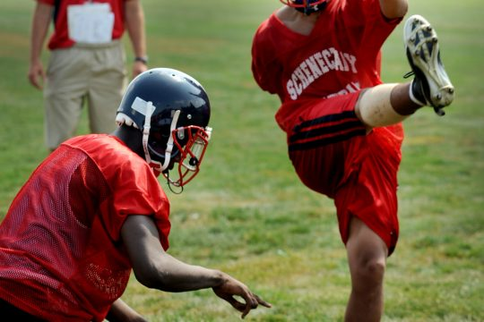 Schenectady High School's Herman Seise, right, practices field goals with teammate Jallah Tarver on Monday.