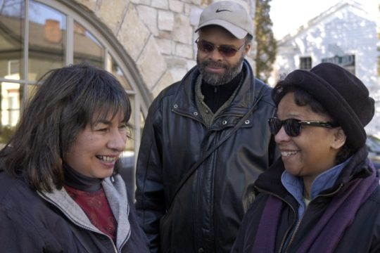 Marina Petro, left, chats with Stephen Tyson and Francelise Dawkins as the two arrive at a fundraiser at The Local Pub and Teahouse for the victims of last week's fire at 153 Grand Ave. in Saratoga Springs. Dawkins was a resident of the building.