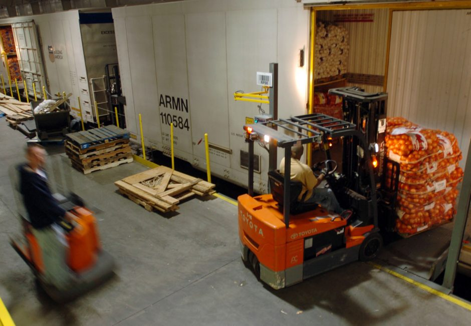 Forklift operators offload 55 railway cars of fresh produce at Railex in the Rotterdam Industrial Complex in August 2008.