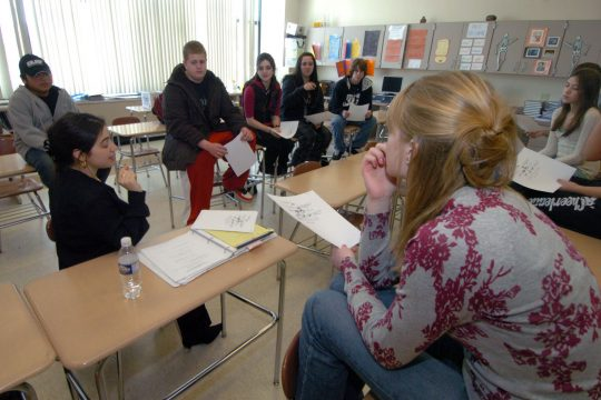 "Cobleskill-Richmondville High School French and Spanish teacher Francesca D'Amico-Bailey, left, conducts a ""freshman forum"" in her classroom last Thursday."