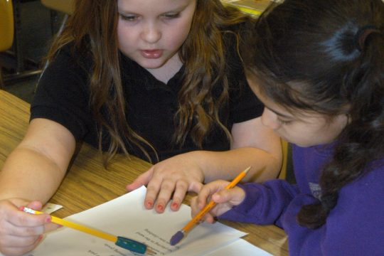 Second grade students in Jerilynn Einarsson's class at Marie Curie Institute of Engineering and Communications in Amsterdam have put together a book of poems they have written. Here Vanessa Bellamy and Amanda Inesti read a poem together in class on