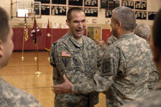 Staff Sgt. Andrew Preville of Albany, center, is congratulated by Command Sgt. Major at the Freedom Salute Ceremony held at Glens Falls High School on Sunday.