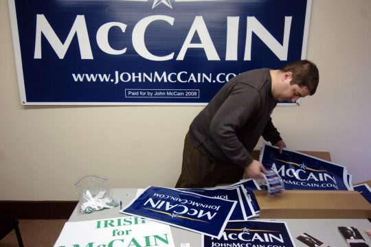 Volunteer Scott Stalker prepares lawn sign posters Saturday at John McCain's Capital Region headquarters in Waterford.