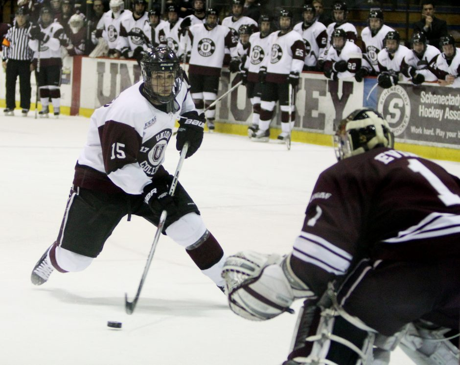 Union's Mario Valery-Trabucco, left, attempts to fake out Colgate's Alex Evin as he takes a penalty shot during their game at Union College in Schenectady Friday.  The shot was blocked by Evin.