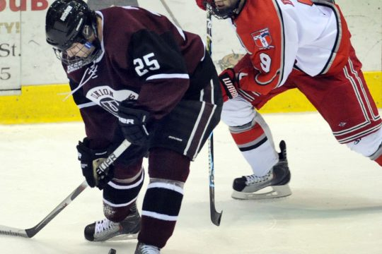 Union's Stephane Boileau, left, tries to handle the puck while being pressured by RPI's Jerry D'Amigo on Wednesday.