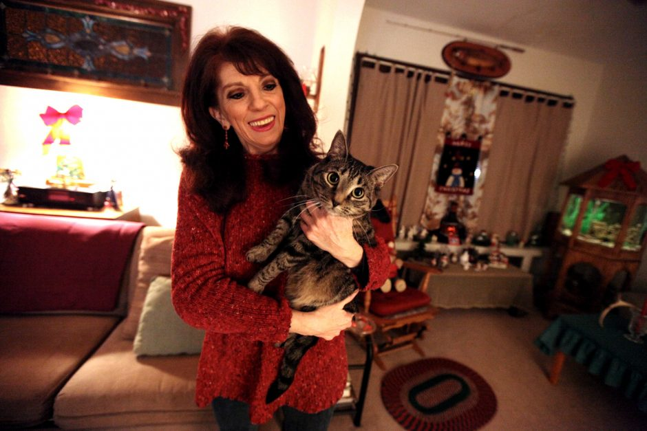 Nancy Bonesteel holds her cat Boo at her home in Schenectady Friday.