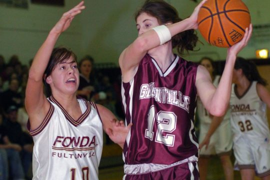 BRUCE SQUIERS/ GAZETTE PHOTOGRAPHER- --FONDA-FULTONVILLE'S Molly Sullivan challenges Greenville's Katie Benninger in first period action of sectional basketball game played Tuesday in Fonda