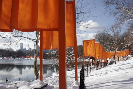 Visitors stroll through the gates in the art installation at New York's Central Park in February 2005.