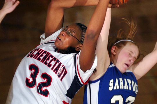 Schenectady's Antonia Williams, left, fights for a rebound with Saratoga's Kathleen Conley, right, during Wednesday's Sectional game at Schenectady high school.