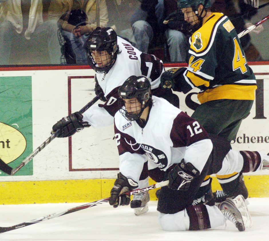 --Union's Torren Delforte, foreground, and Matt Cook play the puck off the wall as Clarkson's Grant Clitsome tries to interfere in second period ECAC hockey action Friday night in Schenectady's Messa Rink.