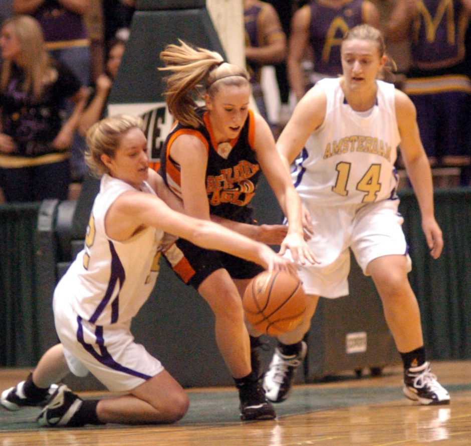 Bethlehem's Taylor Teal, center, gets flanked by Amsterdam's Meghan Power, left, and Ashley Welytok as they all chase a loose ball in first quarter sectional action at HVCC on Wednesday.