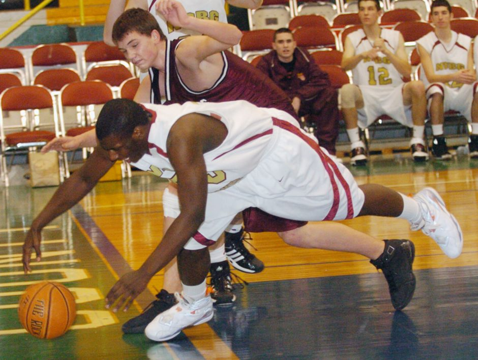 Daylon Coles of Notre Dame-Bishop Gibbons tries to keep the ball inbounds as he stretches under the basket in fourth period Friday in Glens Falls.