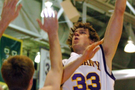 University at Albany's Brian Connelly, right, shoots over Boston University's Matt Wolff during Sunday's game at the University of Albany.