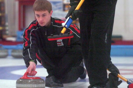 Manotick vice skip Graham Rathwell releases the stone during the Green Junior Curling finals at the Schenectady Curling Club Sunday.