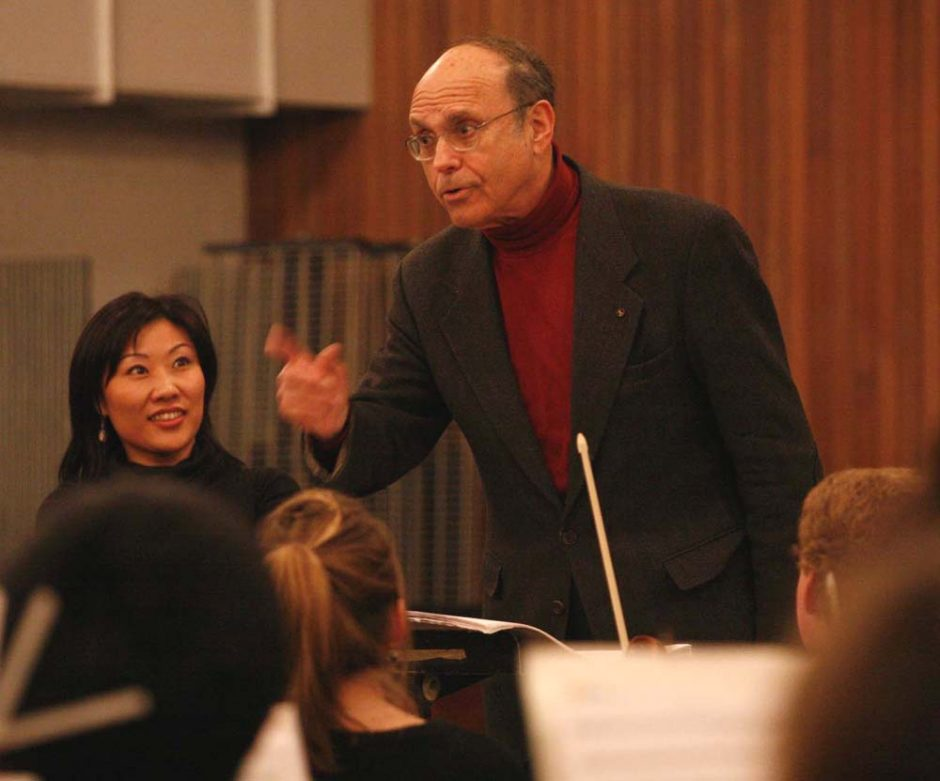 Composer Samuel Adler works with Empire State Youth Orchestra members while conductor Helen Cha-Pyo looks on.