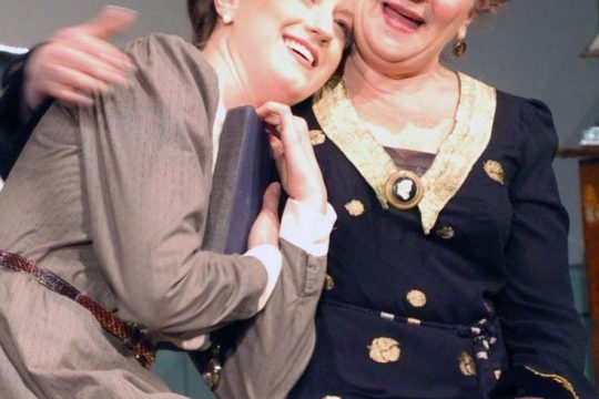 """Katie Ann McDermott, left, as Ellie, is comforted by Eileen Schuyler, as Hesione, during a rehearsal for George Bernard Shaw's """"Heartbreak House"""" at Hubbard Hall in Cambridge."""