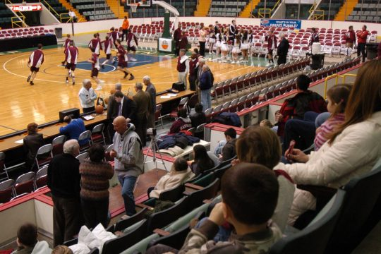 Burnt Hills-Ballston Lake players go through drills out on the court as spectators are seated before a Section II Boys Basketball game last weekend at the Glens Falls Civic Center.