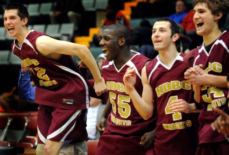 Joe Gallagher, left, Daylon Coles, Chris Buskey and Nick Sarchioto of Notre Dame-Bishop Gibbons begin to celebrate as they watch the clock wind down to win against Albany Academy Wednesday.