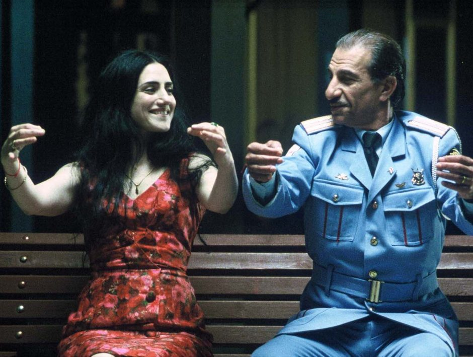 "Ronit Elkabetz, left, as Dina and Sasson Gabai as Tewfiq share a laugh in ""The Band's Visit."""