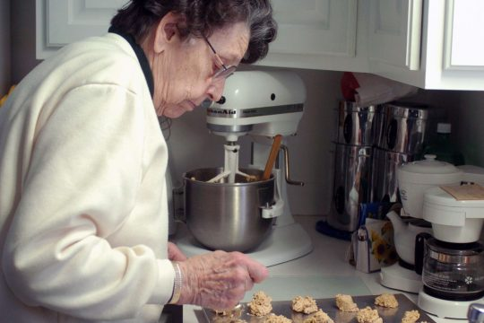 Working in the kitchen of her Delmar home on Thursday, Velma Jones prepares oatmeal cookies for a church reception. The 93-year-old Jones had a hip replaced three years ago and has enjoyed a better quality of life since then.