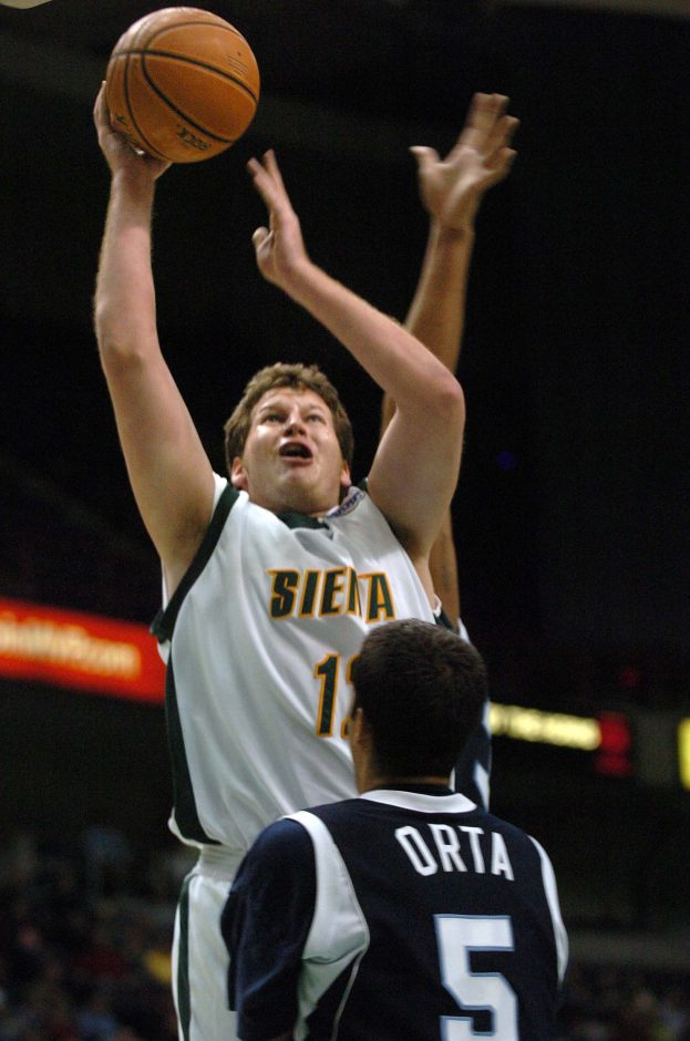 Siena's Josh Duell gets off a shot against Saint Peter's earlier this season.