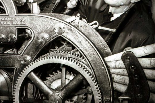 William Wersten inspects the moving parts in Union College's Memorial Chapel clock in 1968.