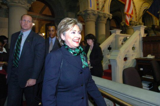 New York senator and Democratic presidential hopeful Hillary Rodham Clinton enters the Assembly chamber before Monday's ceremony.