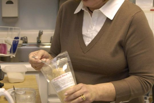 Nurse practitioner Terry Klausner prepares a maca powder lunch shake at her Amsterdam home. She says the powder, made from the maca root, helps ease hot flashes.
