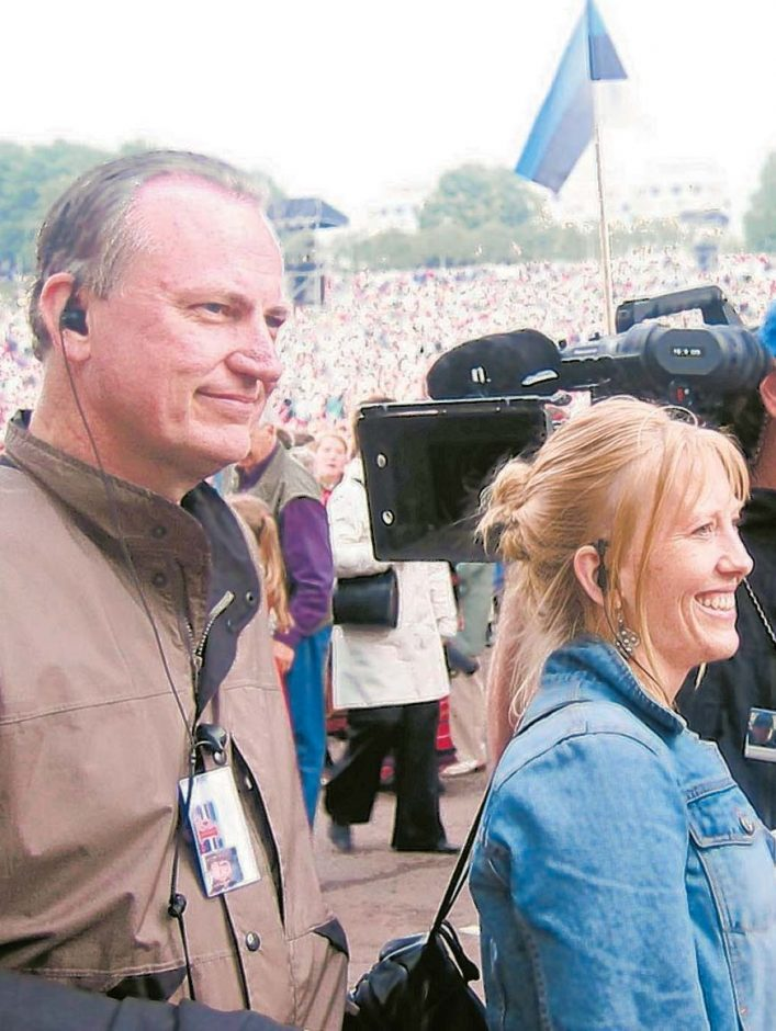 """Jim Tusty and Maureen Castle Tusty are shown during the filming of """"The Singing Revolution."""""""