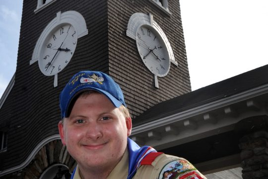 Fred Slurff, Jr. sits in front of the Stone Church on Putnam Road in Rotterdam Junction, where he earned his Eagle Scout badge Thursday.