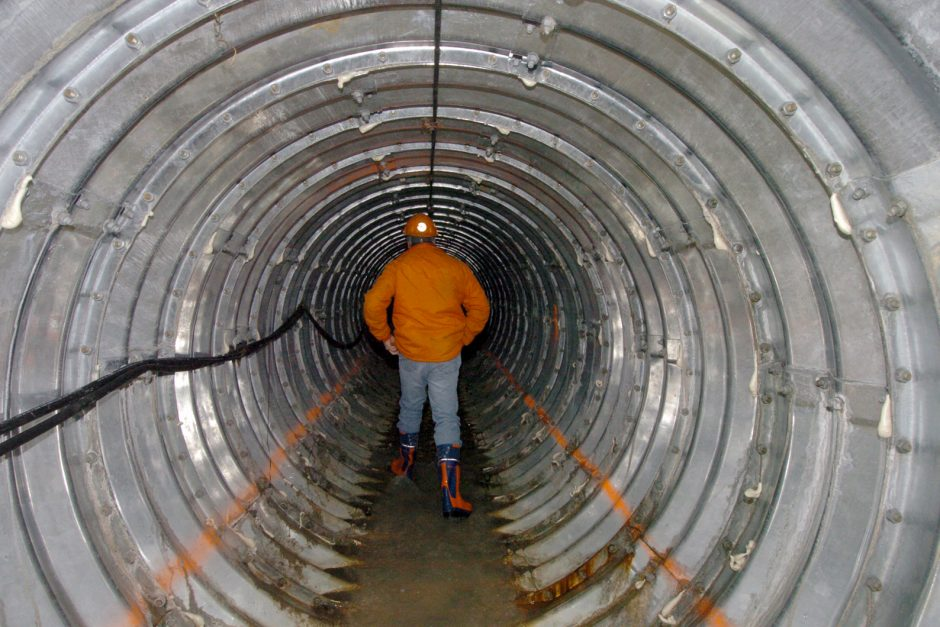 D.O.T. Construction  Inspector, Bruce Sampson, walking inside the huge 7 foot in diameter drainage galvanized pipe, 40 feet under 6 lanes of I-890 in Schenectady.  Over 77,000 bolts were used to attach sections of galvanized pipe together.