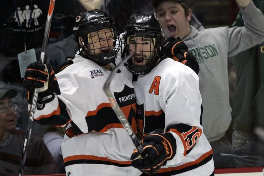 Princeton's Mike Moore, left, celebrates his first-period goal with teammate Brandan Kushniruk during the ECAC Hockey championship game against against Harvard Saturday night at the Times Union Center.  (AP Photo/Mike Groll