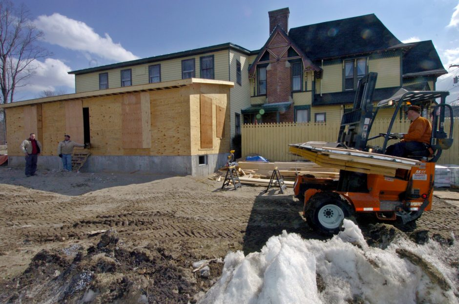 Construction crews from Versatile Home Improvements, Amsterdam, have more building materials dropped off at the St. Jude Retreat House on Church St. in Hagamen, for the addition being built. St. Jude retreat is owned by the Baldwin Research Institute, Inc