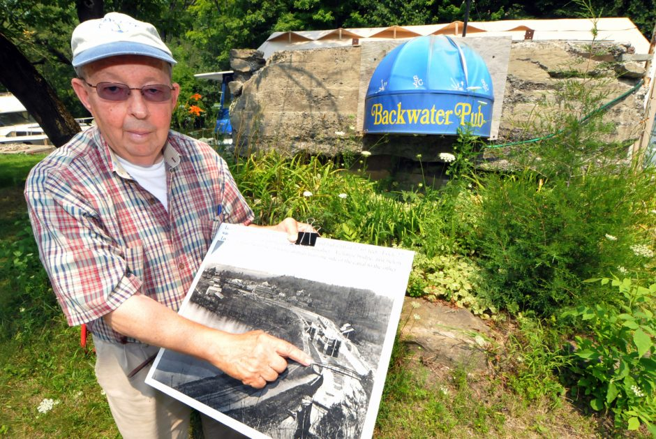 Retired New York State Canal System director John Jermano points to an old photograph, showing exactly where the Backwater Pub is located on the grounds of the Schenectady Yacht Club.