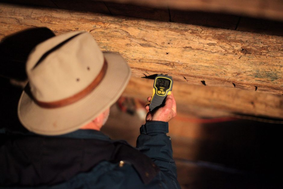 Mike Reed, a volunteer from the Reformed Church, measures the moisture level with a hygrometer in the basement of a house on Fair Street in Schoharie on Friday, October 28, 2011.