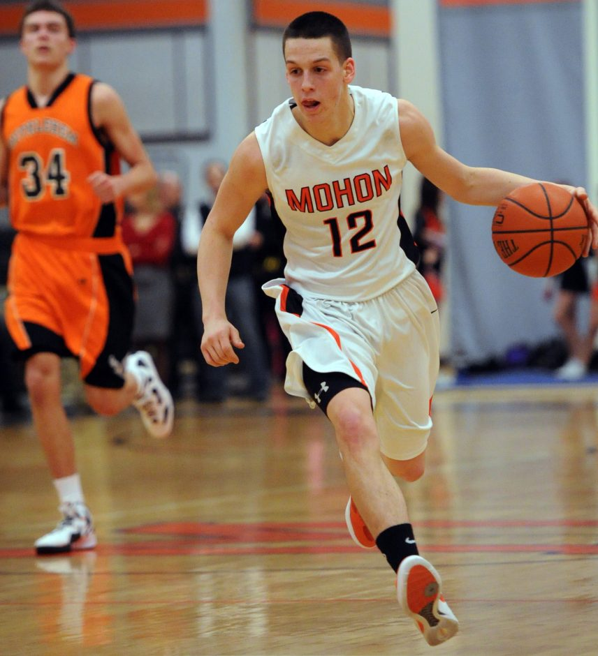 Mohonasen senior Killian Tallman brings the ball upcourt against Bethlehem.