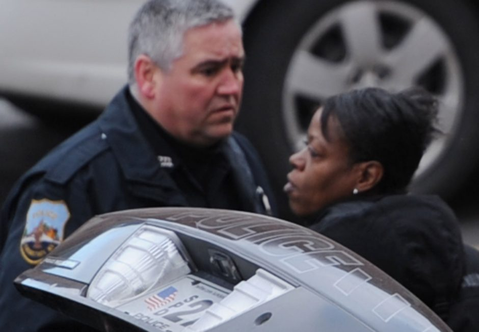 A woman is shown in police custody after a stabbing incident in downtown Schenectady this morning.