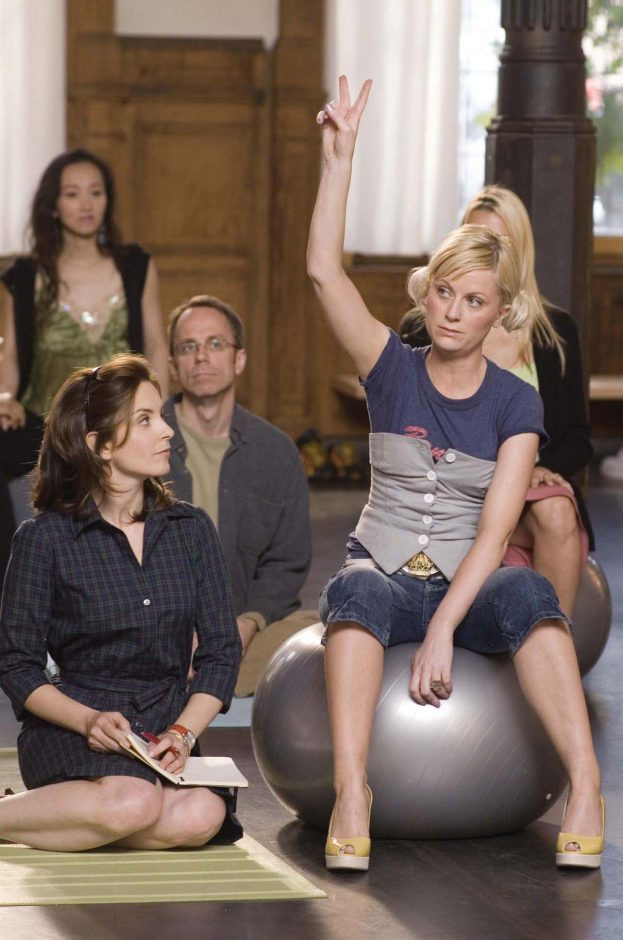 """Single businesswoman Kate Holbrook (Tina Fey), left, attends Lamaze with her surrogate, working girl Angie Ostrowiski (Amy Poehler), in the film """"Baby Mama."""""""