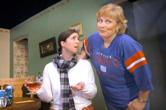 Sarah Wasserbach, left, playing Florence Unger, and Amy Birchler, right, playing Olive Madison, rehearse a production of Neil Simon's The Odd Couple at the Colonial Little Theatre in Johnstown Monday. The play opens tonight.