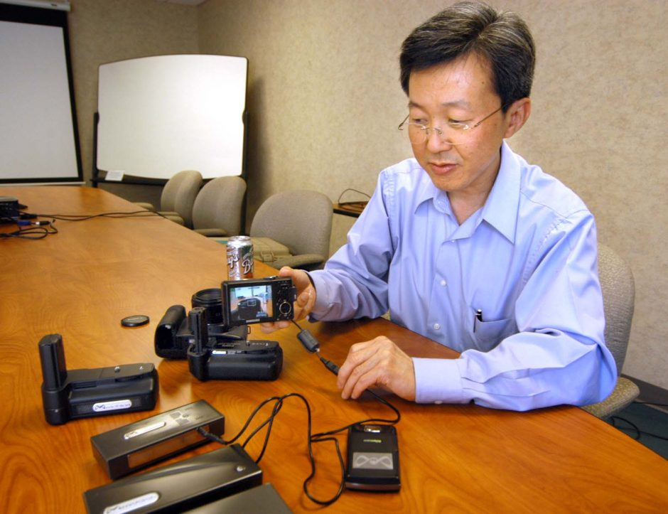 Peng Lim, president and chief executive officer of MTI Micro Fuel Cells in Albany, holds a GPS prototype Thursday that has had the battery replaced with a fuel cell.