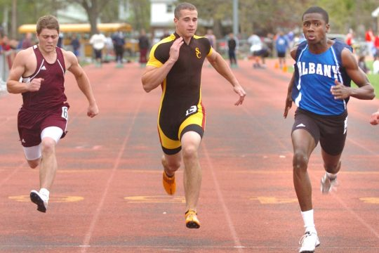 Albany's Kareem Morris, right, heads toward the finish line to win the 100 meter dash during Schenectady  Boys' Invitational Track Meet Thursday at the school. Trailing Morris is Chris White of South Colonie, center, and Josh DiMezza of Glover