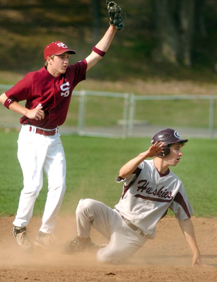 Tom Garnet of Scotia-Glenville shows the ball after tagging out Chris LeFever of Gloversville on a steal attempt in the first inning.