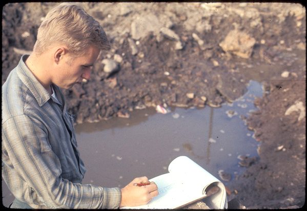 A young Paul Huey takes notes during the excavation of the Fort Orange site in downtown Albany in November 1970.